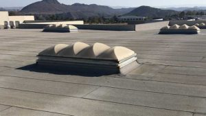 before coating a commercial flat roof
